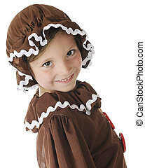 Hi! I'm a Gingerbread Girl - Close up of a young elementary...