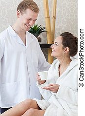 Woman flirting with man in spa