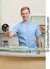 Male receptionist with okay gesture