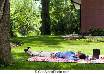 Woman relaxing outside after work - Woman relaxing after...