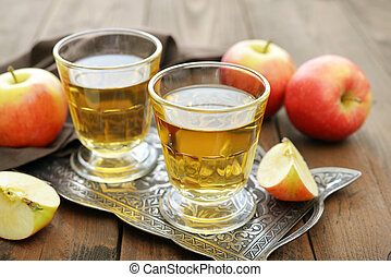 Apple juice with fresh apples on wooden  background