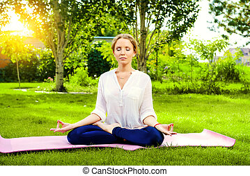soul harmony - Beautiful young woman doing yoga in the...