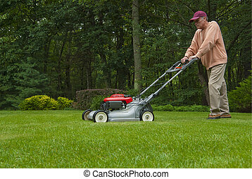 Man mowing lawn - middle aged man mowing lawn in suburban...