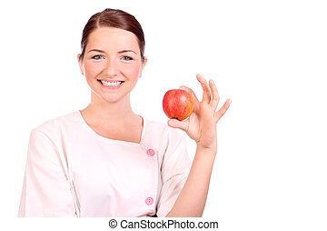 Nurse holding up an apple - A pretty young nurse/dietician...