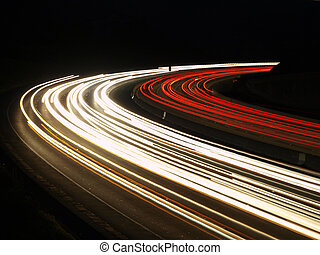 Fast Curve - Night rush hour traffic on a busy California...