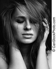 Young woman crying - Young pretty woman with smeared mascara...