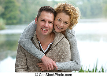 Happy mature couple smiling outdoors