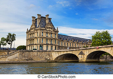 Paris - View of the famous museum Louvre from the Seine...