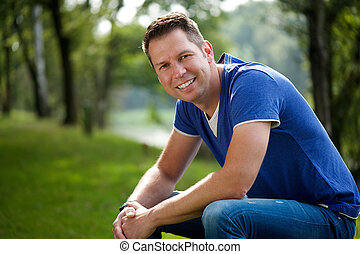 Mature man smiling outdoors - Close up portrait of a mature...