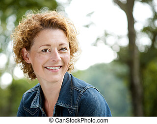 Cheerful older woman smiling outdoors - Portrait of a...