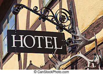 Metal hotel sign - Image of unique old metal hotel sign