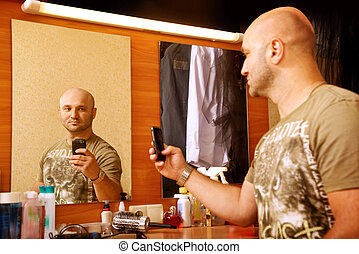 Man photographs herself in the mirror. Beauty salon,...