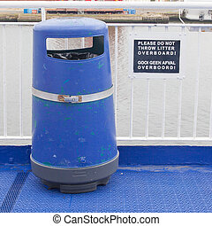 Blue bin on deck of cruise liner, do not throw litter...