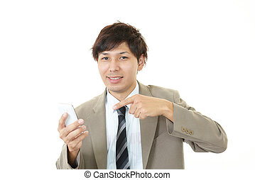 Smiling Asian businessman - Business woman holding a smart...