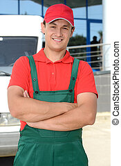 Delivery - Smiling young male postal delivery courier man in...