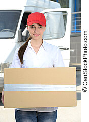 Delivery - Portrait of female delivery driver with clipboard...