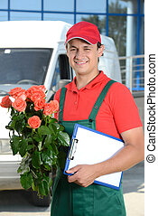 Delivery - Smiling young male delivery courier man in front...