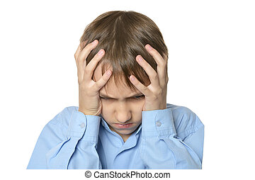 Little boy with headache on a white background