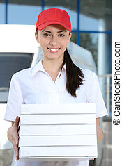 Delivery - Female courier delivery pizza on background car...