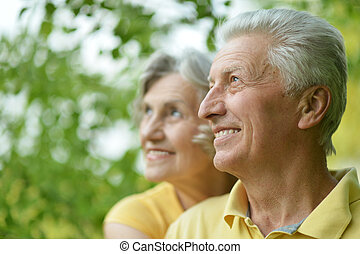Old people embracing outdoors - Portrait of beautiful old...