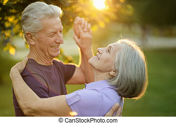 Mature couple dance - Happy Mature couple dance in the park...