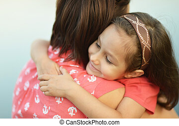 girl hugging her mother - Little girl hugging her mother...