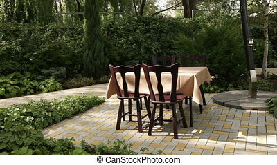 Table and chairs in park - Panorama of standing table and...