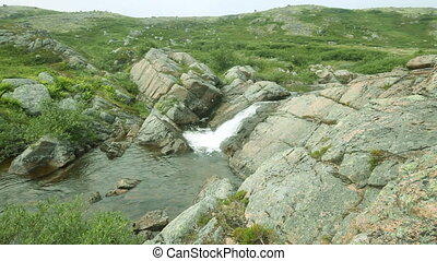 Arctic falls the river in tundra summer