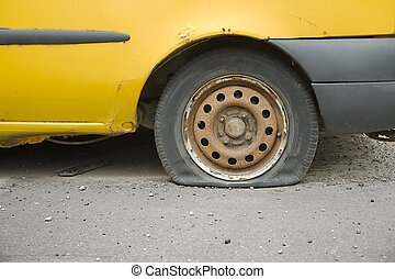 Flat Tire - Flat tire of an old car