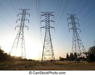 Triple Power Towers - Three power towers at sunrise in...