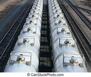 Tanker Cars - Clean white tanker cars sitting on railroad...