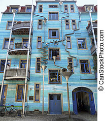blue house facade including lots of art elements seen in...