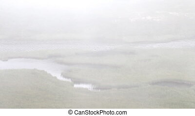 tundra, polar circle the river in fog - foggy weather in the...