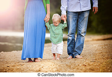 Family by the lake - Happy young family spending summer time...