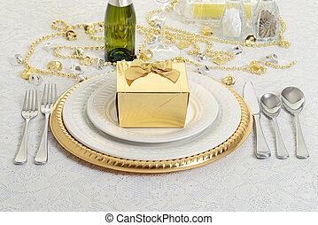 silver and gold table setting