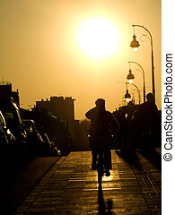 Cyclist at sunset - Cyclist on the sidewalk of the Pont Neuf...