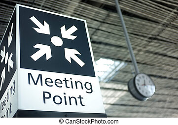 Meeting point sign at the airport - Meeting point sign in...