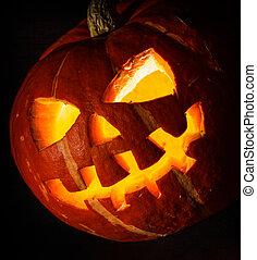 Halloween - old jack-o-lantern on black background