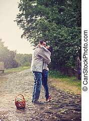 Young couple kissing under rain - Young couple in Ukrainian...