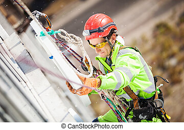 Industrial climber during insulation works - Industrial...
