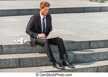 Businessman working outdoors Confident young man in shirt...