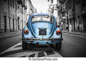 Old blue car in a black and white city