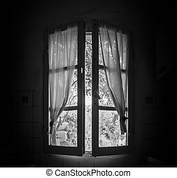 Old window in a dark room in a sunny day