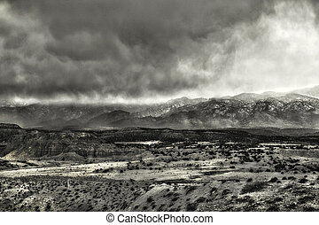 High Desert Storm Clouds - Snowstorm blowing over the...