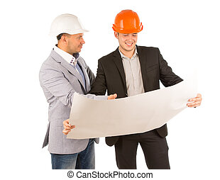Two young architects discussing a building plan