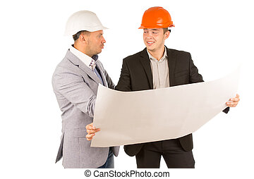 Two architect partners discussing a blueprint