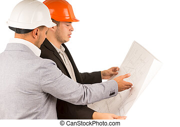 Architect and engineer looking at a blueprint