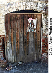 Wooden old door with stone arch
