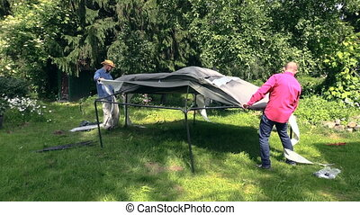 garden bower cloth roof - Father and son put tent cloth on...