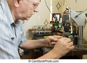 Senior man working at a workbench